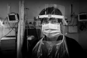Picture of staff nurse in full PPE in the assessment suite at the RVI
