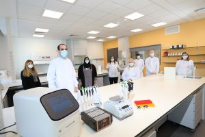 Staff from the innovation lab in masks and white coats